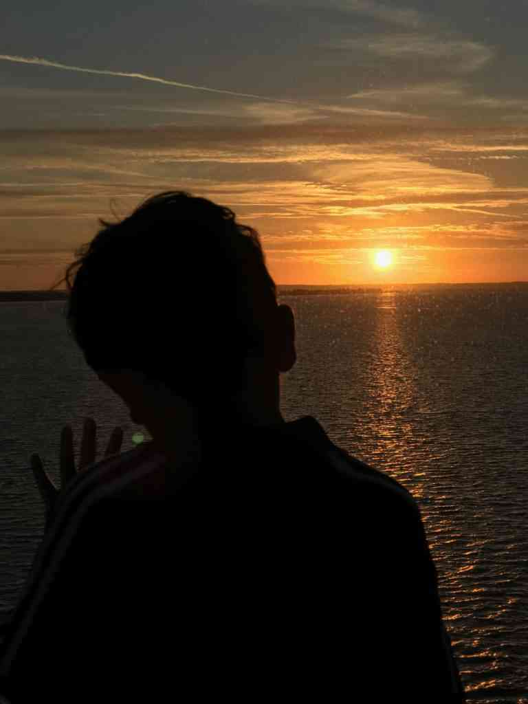 Aarav enjoying sunset from the cruise ship