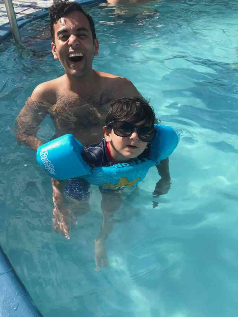 Enjoying with the little one in the pool on the cruise ship
