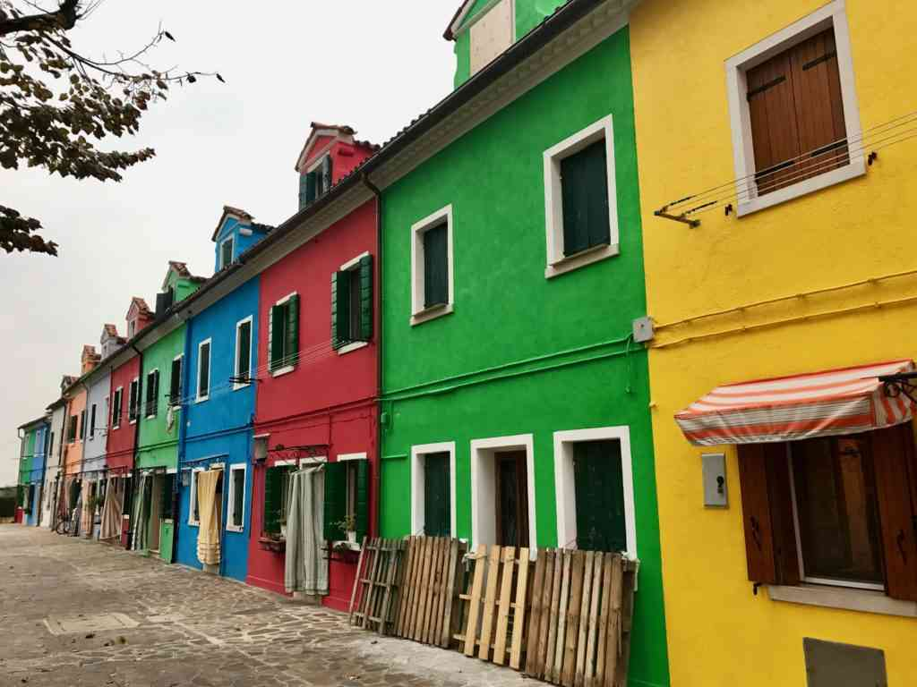 Colorful row of buildings in Burano