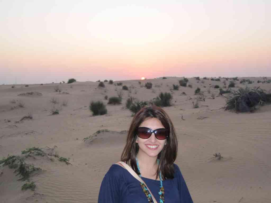 Natasha enjoying a sunset in Dubai's beautiful sand dunes
