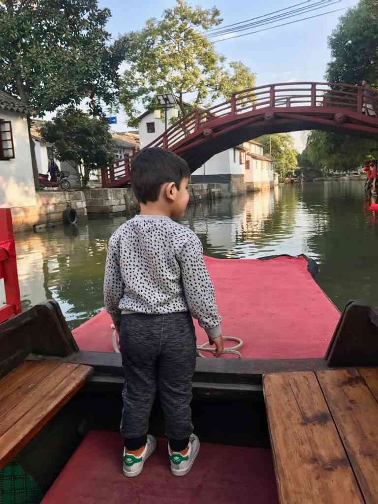 Aarav leading the way on our boat tour in Jinze Ancient Water Town