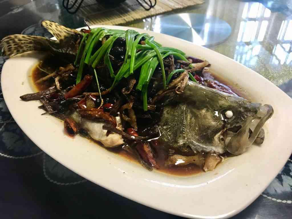 Enjoying a full fish in the Jinze Tea House