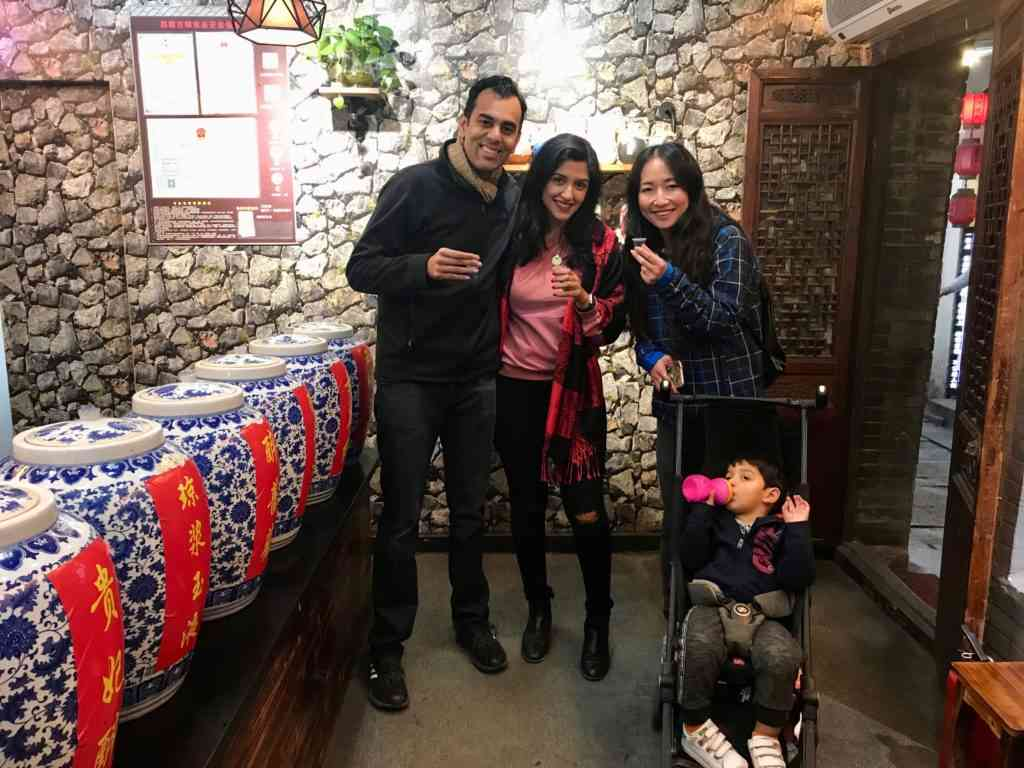 Enjoying baijui in Xitang Water town with our tour guide
