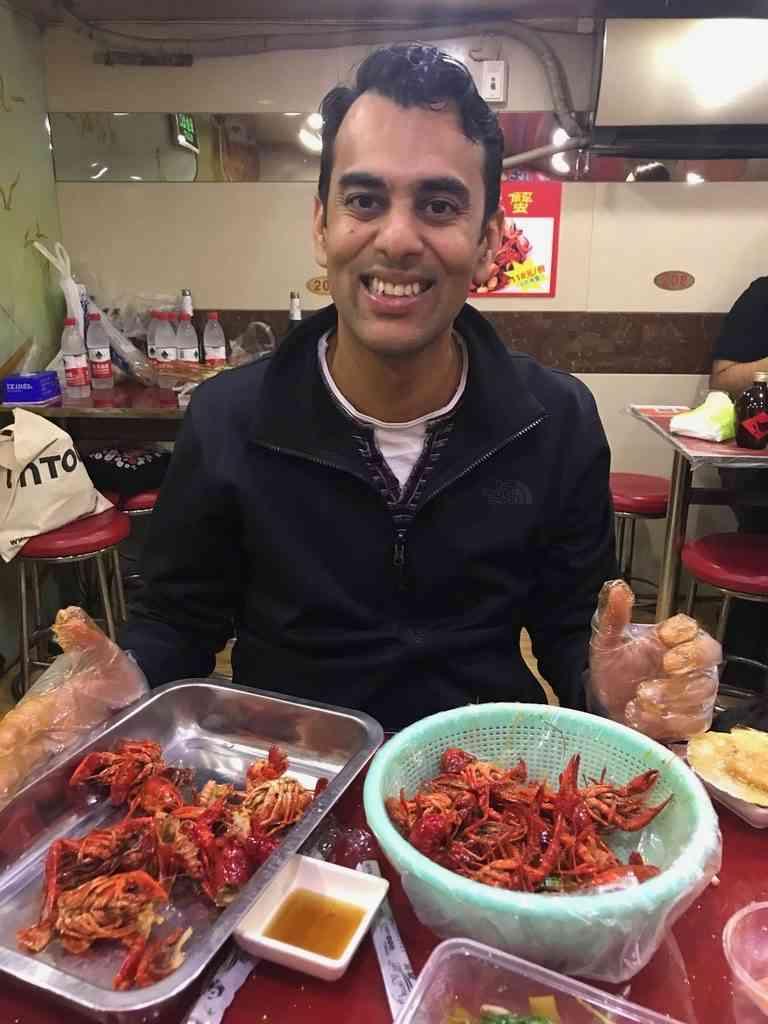 Enjoying spicy crab on the Shanghai Food Tour