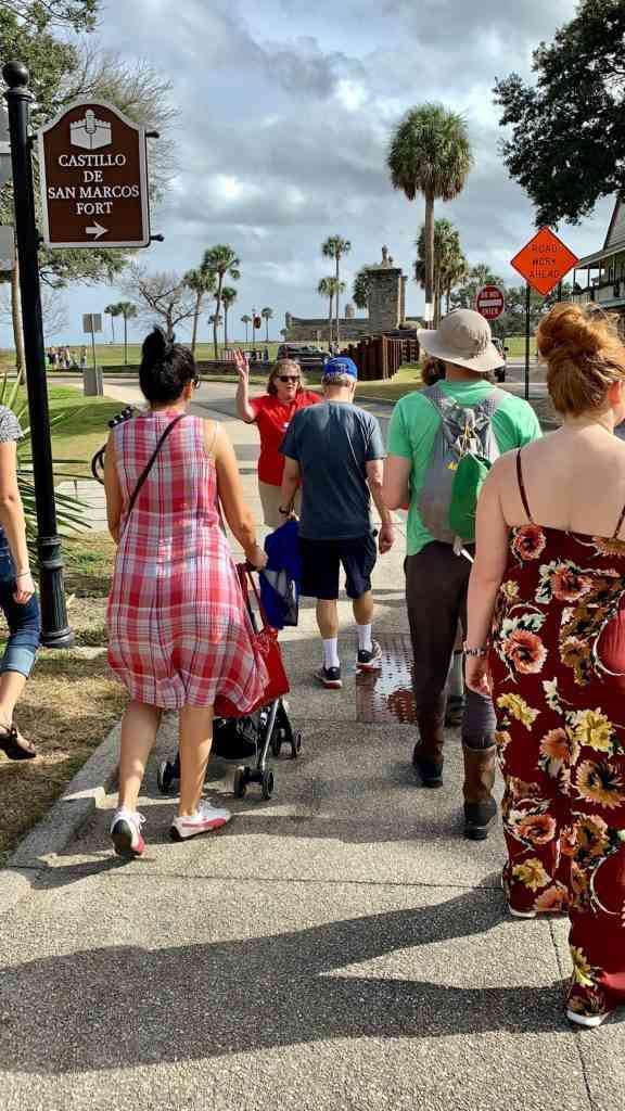 Natasha pushing Aarav on our walking tour in St. Augustine, Florida