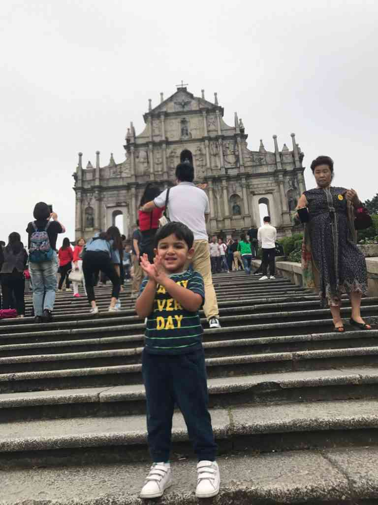 Aarav posing in front of the ruins of St. Paul in Macau's Historic Center