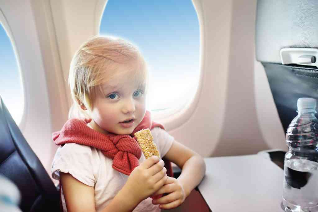 traveling with an infant with snacks on plane