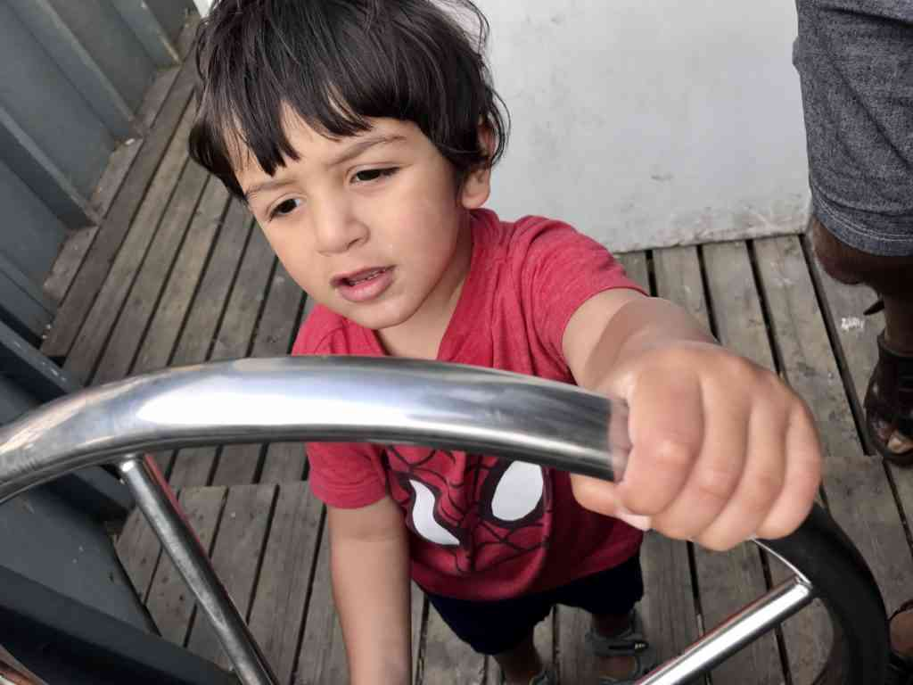 Aarav riding a train at Granville Island in Vancouver