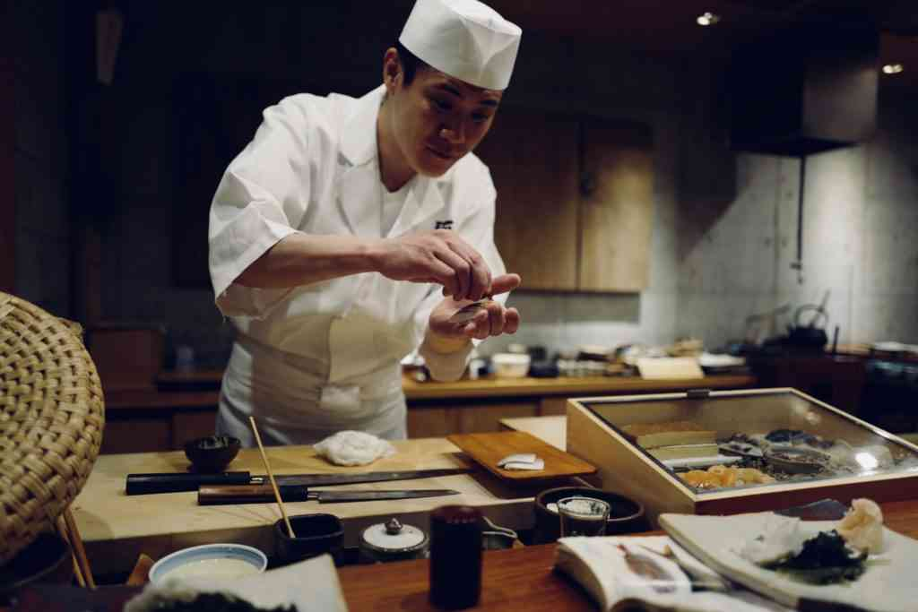 Japanese sushi master showing his skills